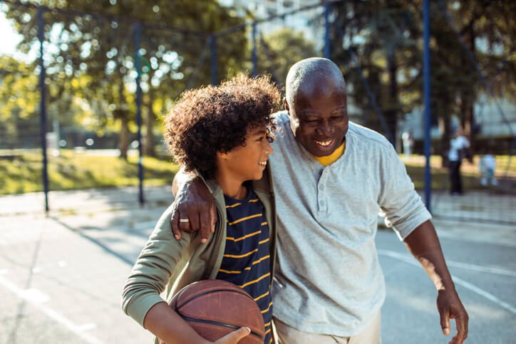 Man Playing Basketball With Grandson