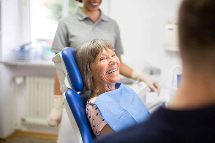 Happy smiling woman in dentist's chair