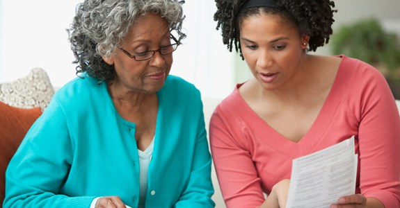 Woman helps her mother review documents