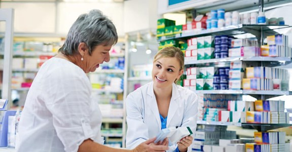 Woman gets help at pharmacy