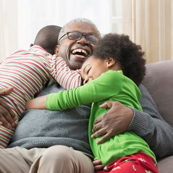 Smiling grandfather with young grandchildren